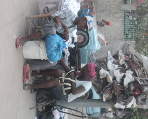 On the journey from the airport to Grand Goave we witnessed a lot of business including this travelling shoe store!